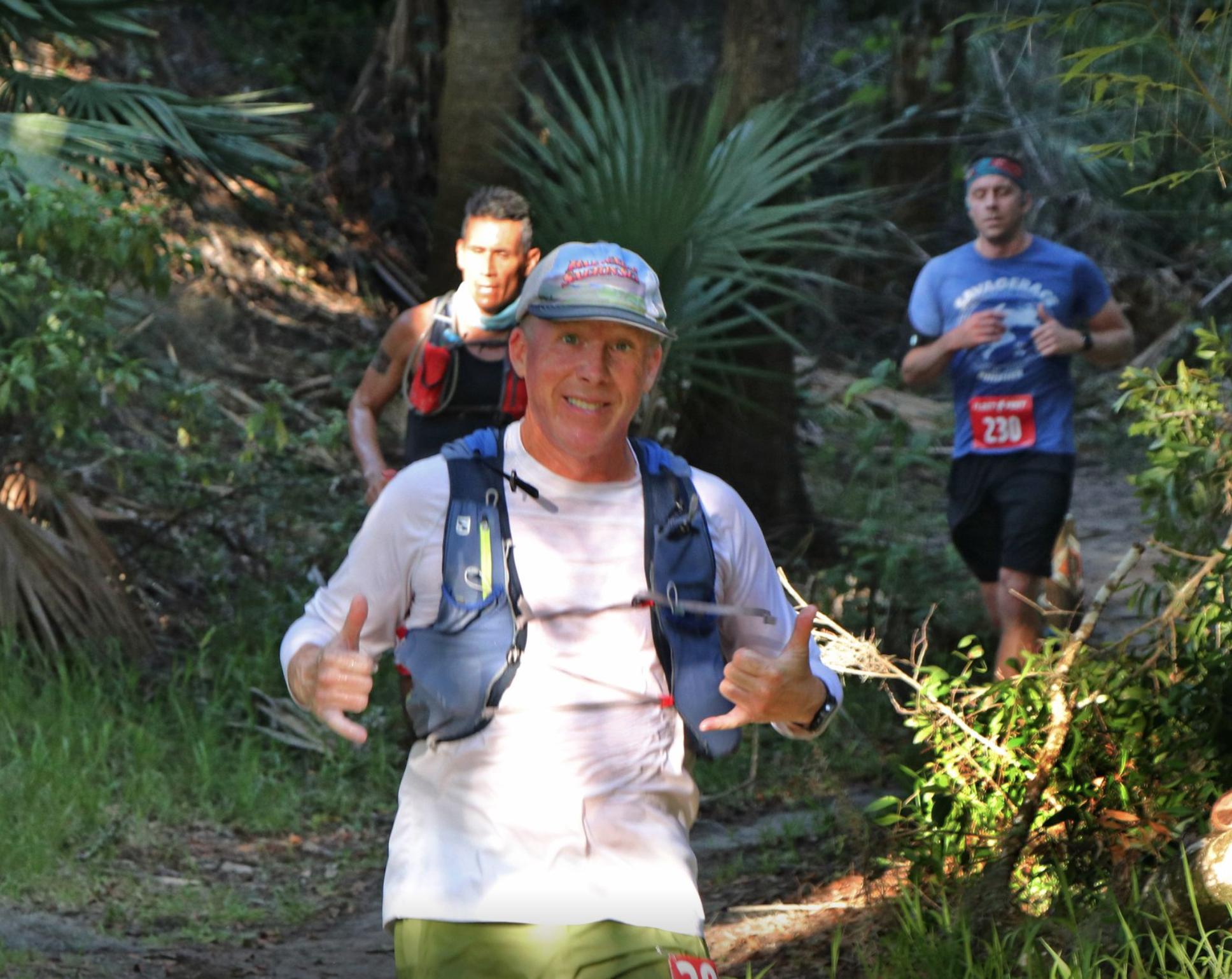Runner on the trail posing